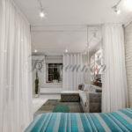Идеи зонирования комнаты разными видами штор